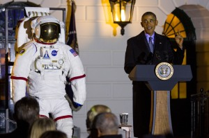 Obama, standing next to an astronaut's space suit, brought together students, teachers, scientists, astronauts and others to spend an evening stargazing on the White House South Lawn. Bill Nye, the Science Guy, and the student from Texas whose homemade clock was mistaken for a bomb, were in the audience. SHFWire Photo by Matias Ocner
