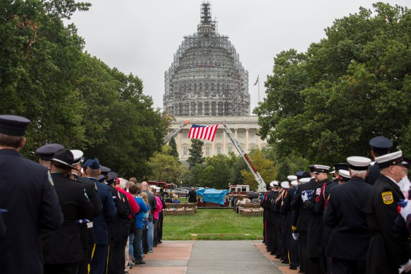 The National Fallen Firefighter Foundation held its second annual congressional flag presentation ceremony Wednesday to honor the lives of firefighters who died in the line of duty. Eighty-seven U.S. flags were flown over the Capitol to symbolize each firefighter killed in the line of duty. SHFWire Photo by Matias J. Ocner