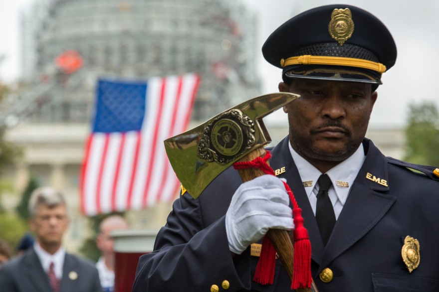 Garry Wilson, 57, a Washington firefighter, participates in the National Fallen Firefighter Foundation's second annual congressional flag presentation ceremony to honor the lives of firefighters who died in the line of duty. Wilson is a firefighter. The ceremony took place Wednesday near the Capitol. SHFWire Photo by Matias Ocner